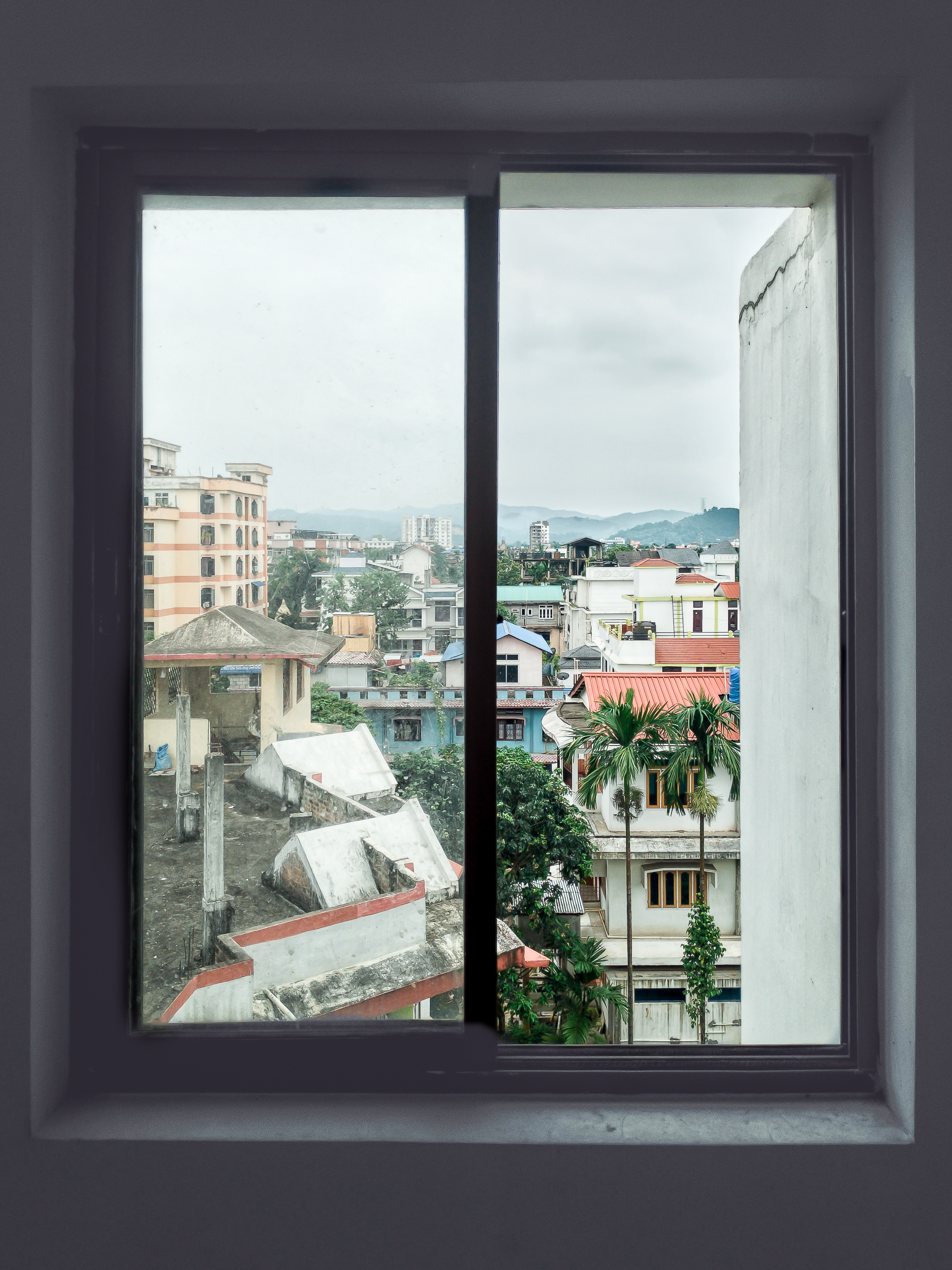 a photo of a view from the window, with the window serving as a frame within a frame in the photo